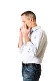 Man holding his nose because of sinus pain Royalty Free Stock Photo