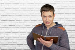 Man holding his notebook Royalty Free Stock Image