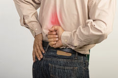 Man holding his painful lower back Stock Photo