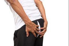 Free Man Holding His Pants. Pants Cracked And Show White Panties. Royalty Free Stock Photos - 102344948