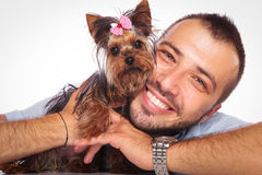 Man is holding his pet yorkshire terrier puppy dog Stock Image