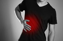 The man is holding his side. Pain in the liver. Cirrhosis. The h stock photos