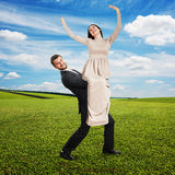 Man holding his smiley happy woman Stock Image
