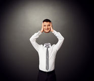 Man holding his smiley head in hands Royalty Free Stock Photography
