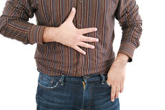 Man holding his stomach in pain Stock Photo