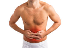 Man holding his stomach in pain. Man in pain holding his stomach Stock Photos