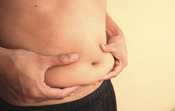 Man is holding his too fat tummy Royalty Free Stock Image