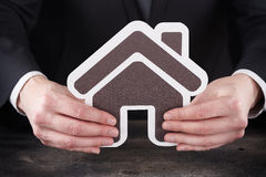 Man holding home page icon in hands Royalty Free Stock Image