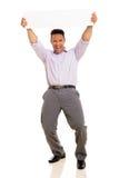 Man holding horizontal board Stock Images
