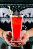 Man holding hot cranberry tea with lemon stock images