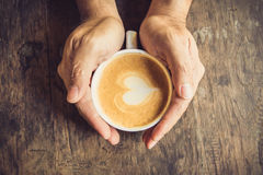 Man holding hot cup of coffee. Stock Photos