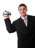 Man Holding House in Hand Royalty Free Stock Image