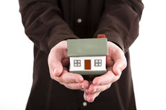 Man holding house in his hands Royalty Free Stock Photo