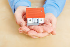 Man holding house in his hands Royalty Free Stock Photos