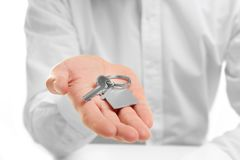 Man holding house key in hand Royalty Free Stock Images