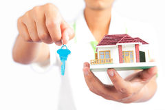 Man holding house key Royalty Free Stock Photo