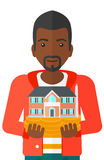 Man holding house model. Royalty Free Stock Image