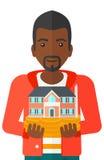 Man holding house model. Royalty Free Stock Image