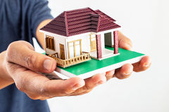 Man holding house model Stock Images