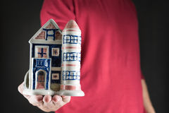 Man holding house .real estate investment concept Royalty Free Stock Photos