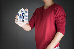 Man holding house .real estate investment concept Royalty Free Stock Photography