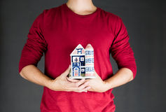 Man holding house .real estate investment concept Royalty Free Stock Photo