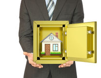 Man holding house in safe Stock Images