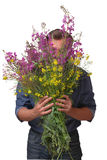 Man holding a huge bouquet Stock Images