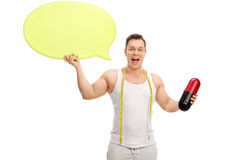 Man holding a huge diet pill and speech bubble Stock Photography