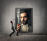 Man holding a huge picture Stock Image