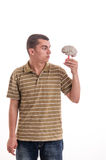 Man holding a human brain model and looked at him Royalty Free Stock Images