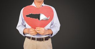 Free Man Holding Hurt Love Heart With Torn Paper Royalty Free Stock Photo - 109389935