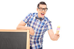 Man holding an ice cream behind a blackboard Royalty Free Stock Image