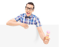 Man holding an ice cream behind blank panel Stock Photography