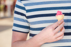 Man holding ice cream in hand Royalty Free Stock Photo