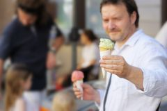 Man holding ice cream Stock Image