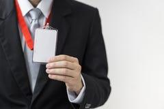 Man holding Identification card. Stock Image