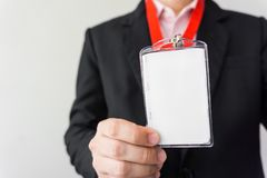 Man holding Identification card. Royalty Free Stock Images