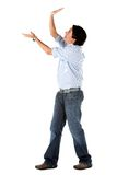 Man holding an imaginary object Stock Image