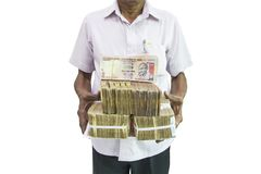Man holding Indian currency notes on white  background Stock Photos
