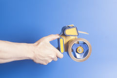 Man holding an industrial tape dispenser stock image