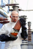 Man holding industrial tube Royalty Free Stock Images