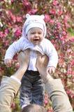 Man holding infant Stock Photo