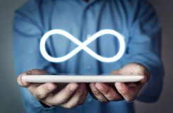 Man holding Infinity symbol. Business concept stock image