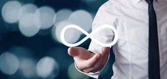 Man holding Infinity symbol. Business concept royalty free stock photos