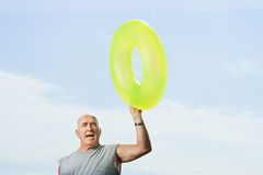 Man holding an inflatable ring Royalty Free Stock Images