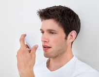 Man Holding Inhaler Stock Photo