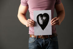 Man holding ink drawing of heart Royalty Free Stock Image