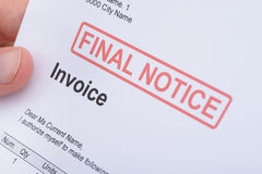 Man Holding Invoice With Final Notice Stamp Stock Photos