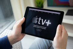 Man holding iPad with Apple TV app provides streaming movies. Anapa, Russia - March 28, 2019: Man holding iPad Pro with Apple TV + app provides streaming movies royalty free stock image